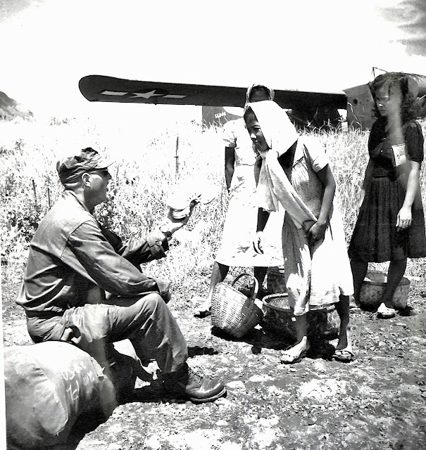 US Army soldier buying banana at Lipa Airstrip before flying out to Okinawa.  Image source:  United States National Archives.