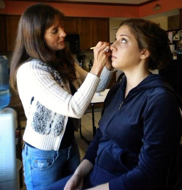 Jill applying makeup