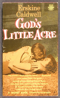 "A cover for ""God's Little Acre,"" showing a man and woman kissing passionately in hay."