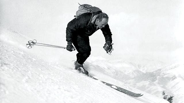 warren miller skiing down a mountain