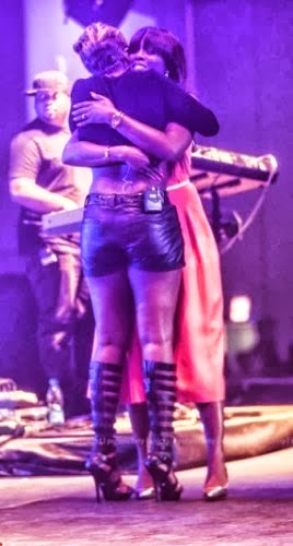 mary j blige tiwa savage hugging on stage