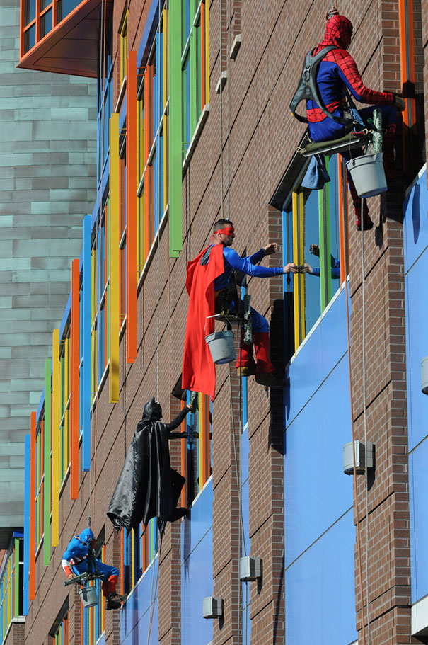 Workers from memphis cleaning company dress up as superheroes to cheer up patients at children's hospital in le bonheur.