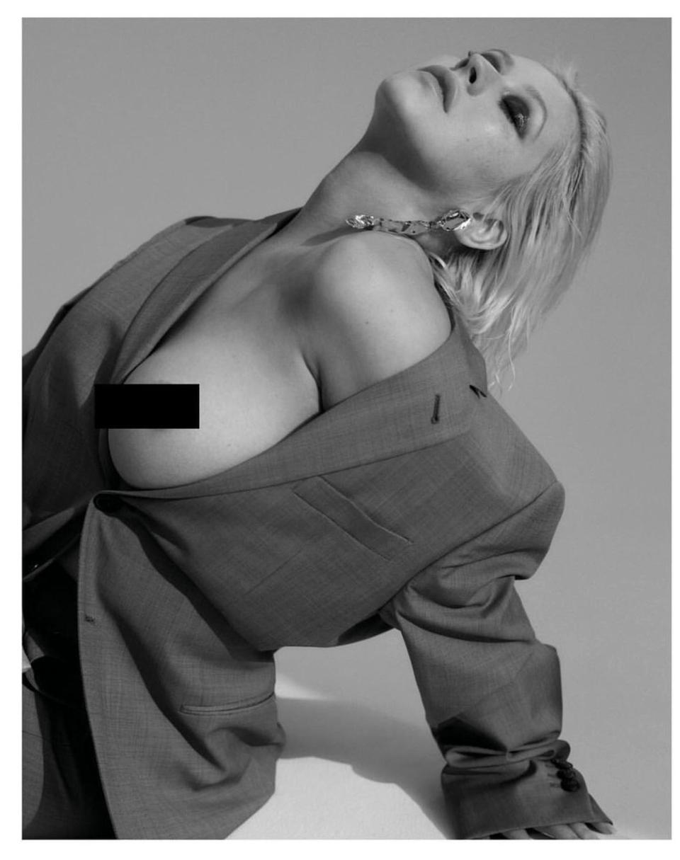 Christina Aguilera poses topless in sizzling shots to promote new album Liberation