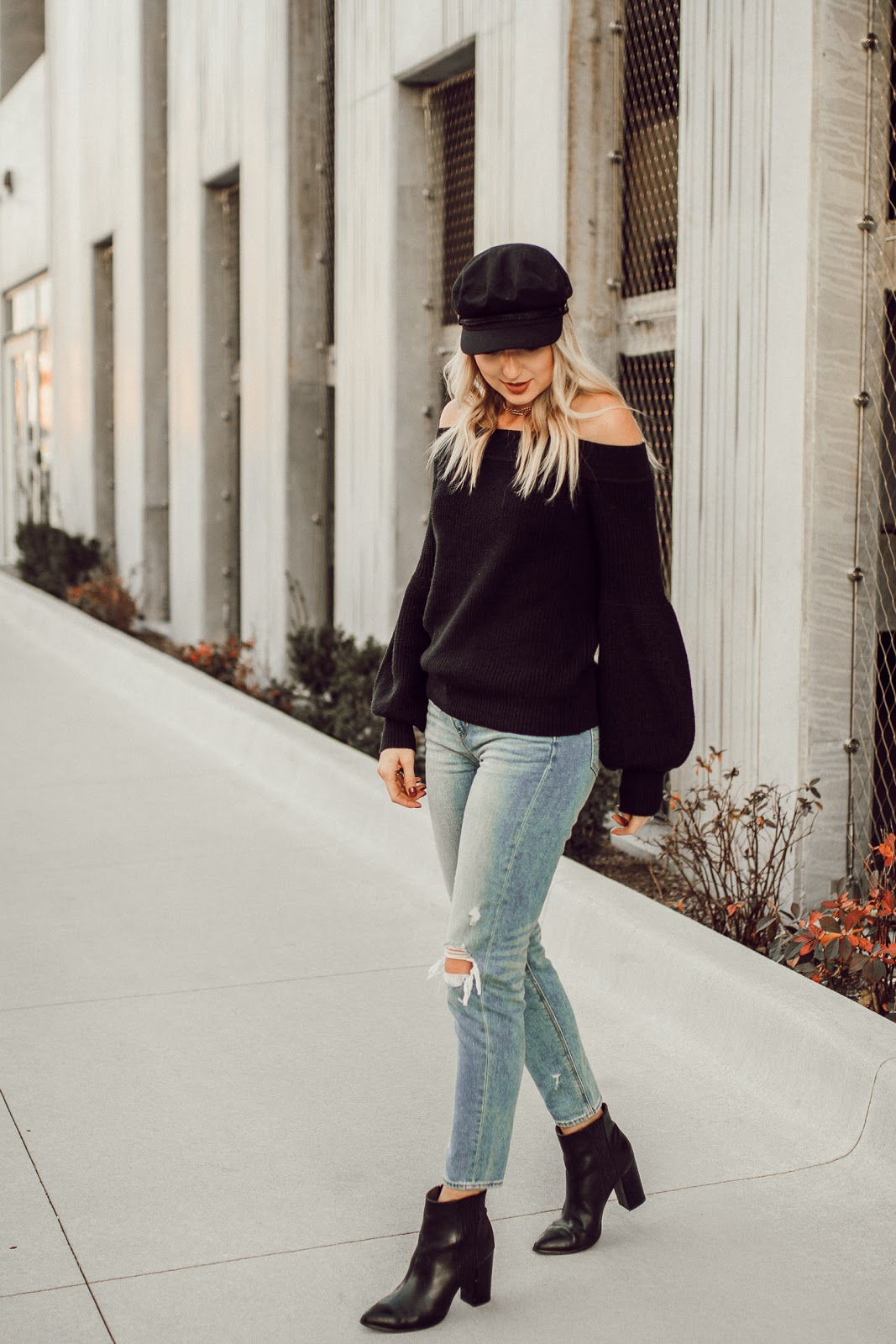 mom jeans with a black sweater & boots