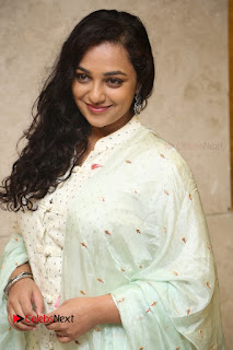 Actress Nithya Menen Latest Pictures in White Dress at 100 Days of Love Movie Audio Launch  0020.JPG