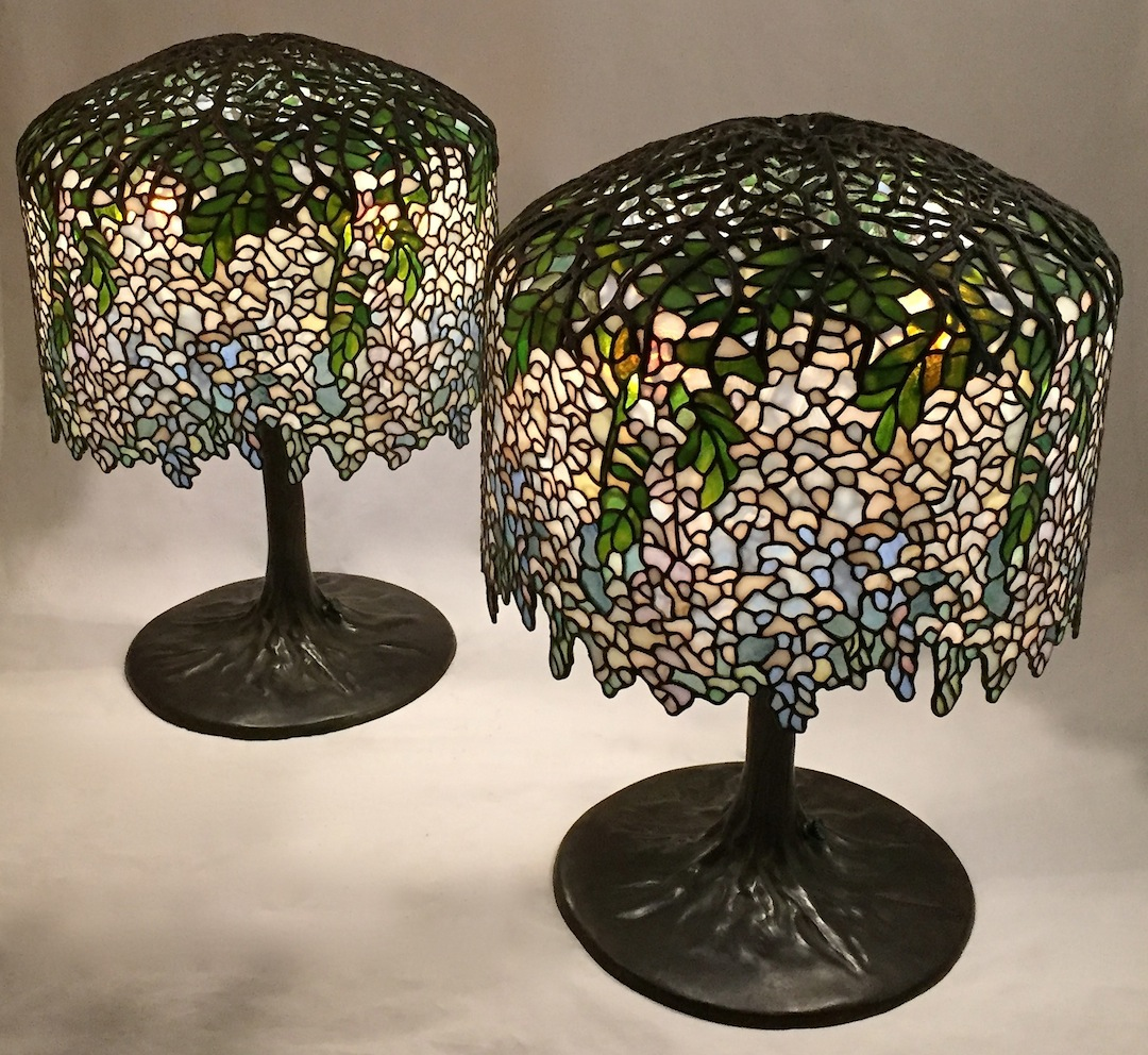 Pair of 18 wisteria lamps completed green leaves give way to cascading flowers which blend together in a subtle shades of white off white lavender periwinkle blue and moonstone mozeypictures Gallery