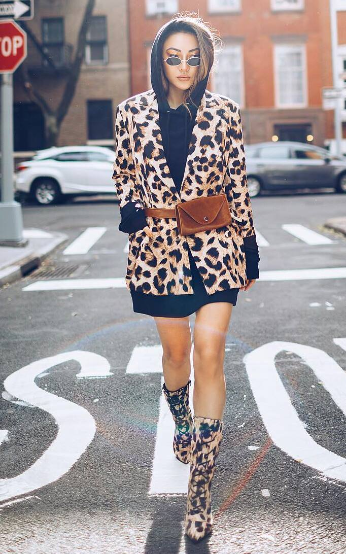 fashionable outfit / leopard coat + black hoodie + waist bag + lace-up boots