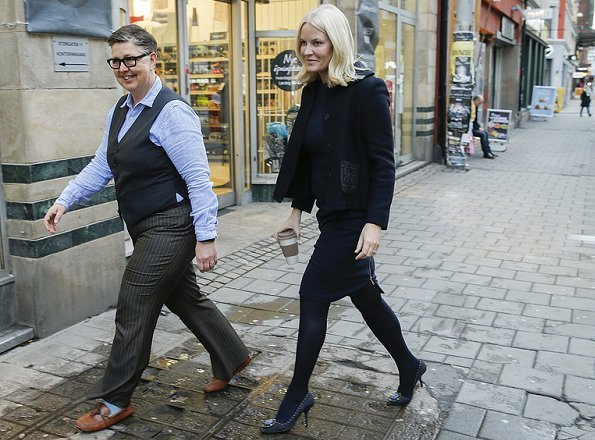 Crown Princess Mette-Marit wore Prada wool satin coat, Prada Pumps, gold diamond earrings