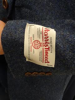 harris tweed logo on tweed suit