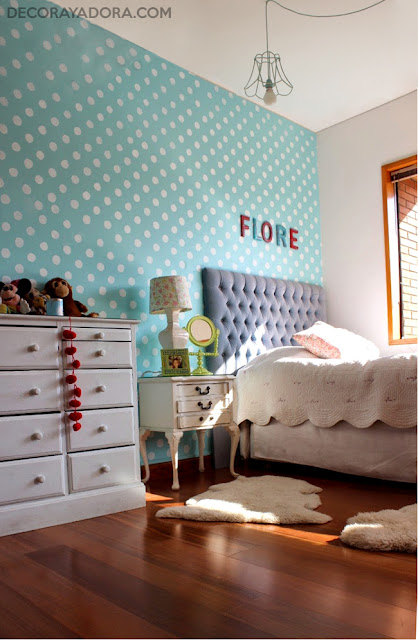 Polka dot accent blue wall in girl room
