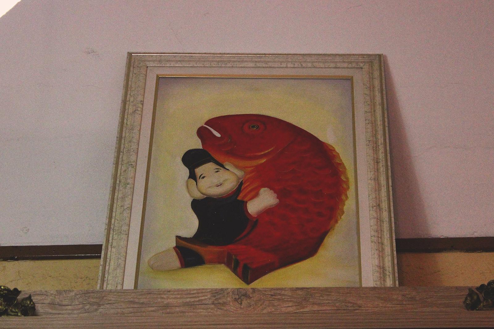 quadro homem peixe