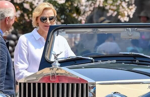 Princess Charlene wore Akris Punto striped flared skirt and white shirt. Prince's Palace of Monaco classical car event