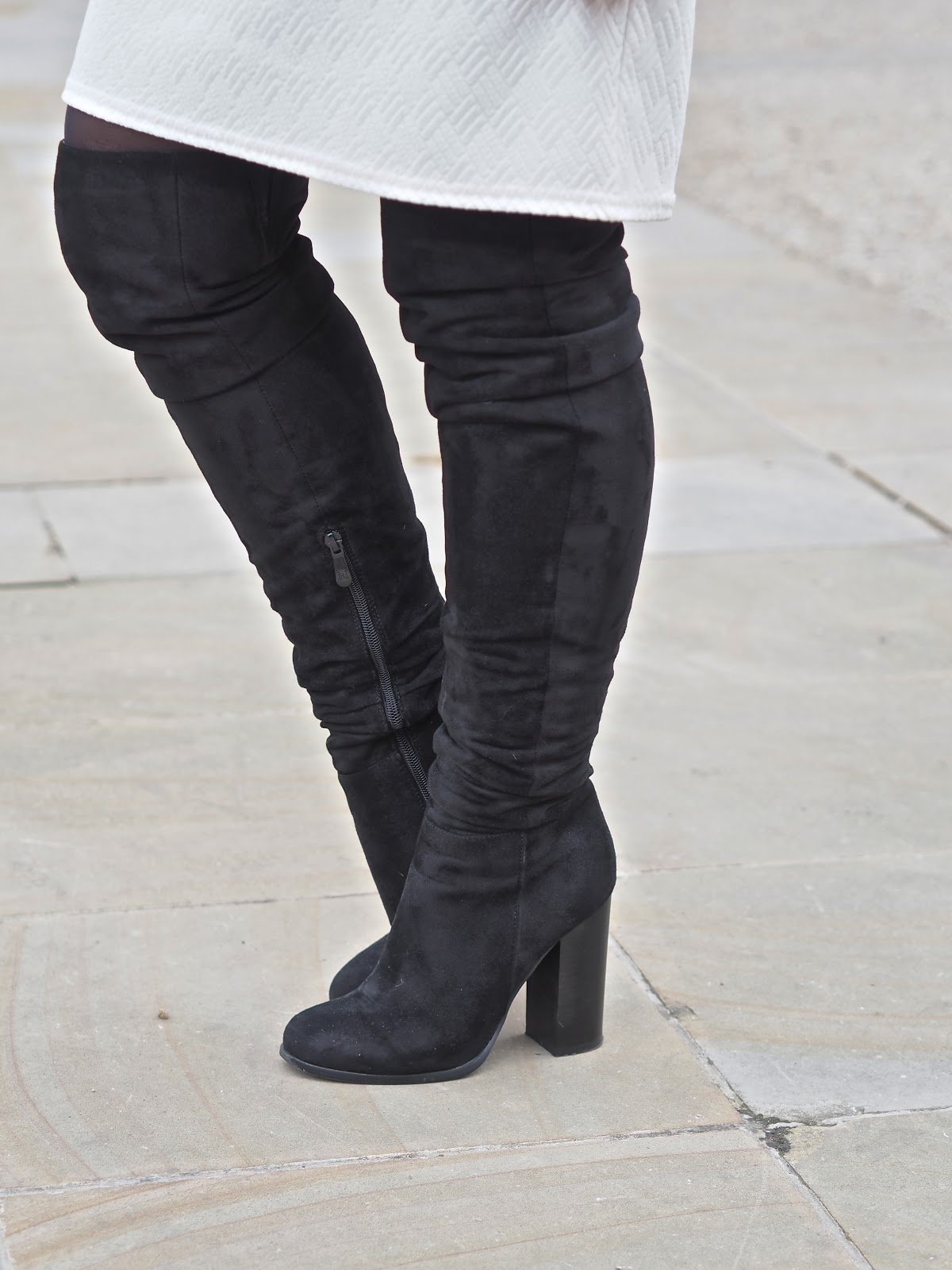 white dress and black thigh high boots in Chelsea, London