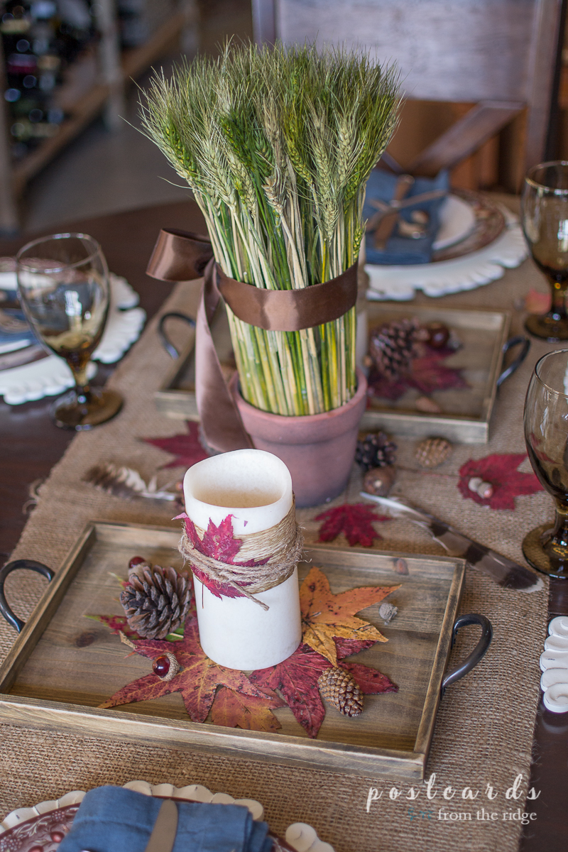 rustic fall centerpiece with leaves and pinecones
