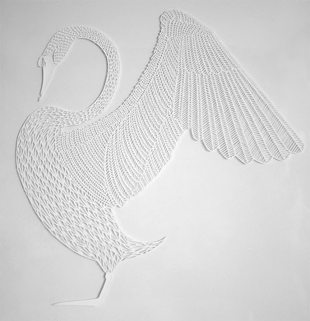 detailed white paper cutting of swan with wings extended