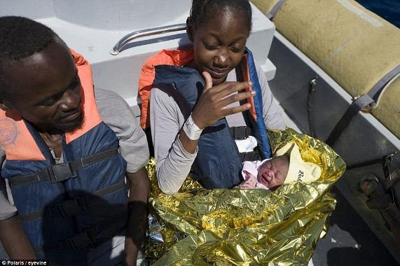 Photos: African migrant delivers baby on Italian patrol boat after being rescued in the Mediterranean Sea