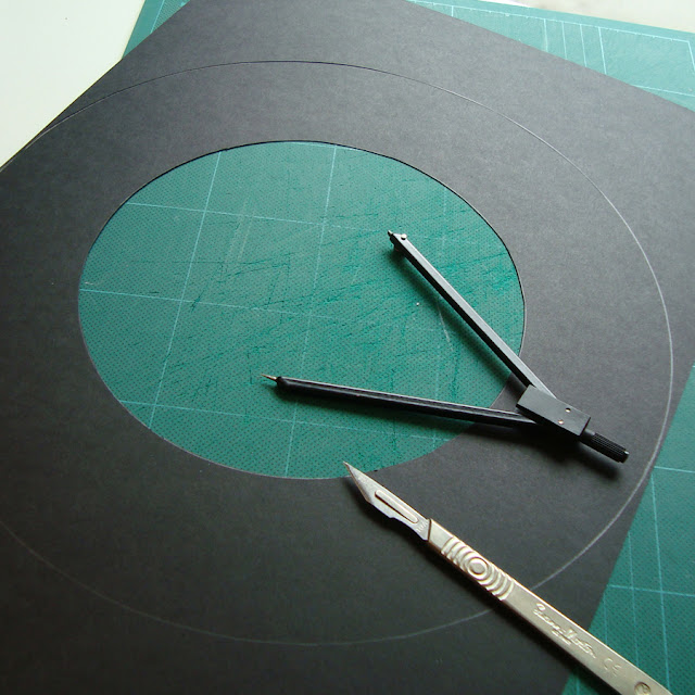 Cutting a brim for a witches hat out of A3 black card