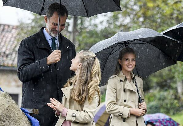 Crown Princess Leonor and Infanta Sofia wore Carolina Herrera trench coat, Mango Prince of Wales trousers. Queen Letizia