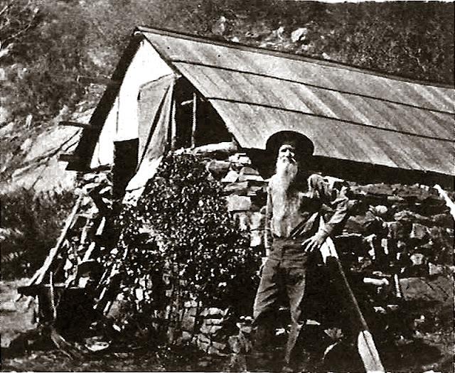 Oliver Justice's cabin in the very early 1900s. In 1929 he was found dead on a cot outside the door.