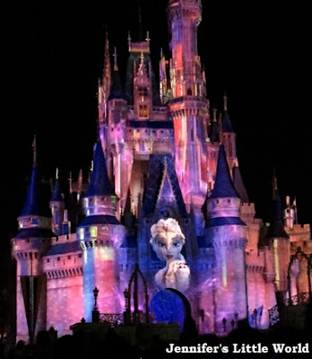 Elsa from Frozen projected onto the castle at Walt Disney World