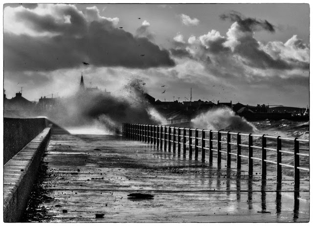 Photo of giant waves crashing onto Maryport Promenade