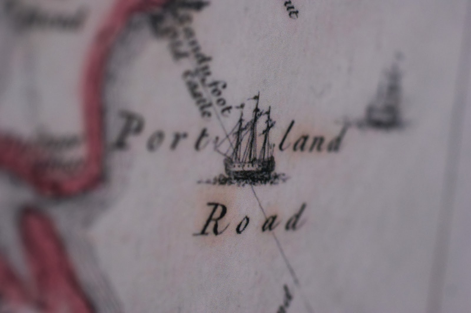 A close-up shot of an old map of Weymouth and Portland showing the words Portland Road