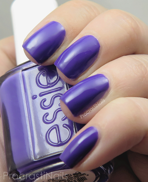 Swatch of the indigo purple nail polish Essie All Access Pass