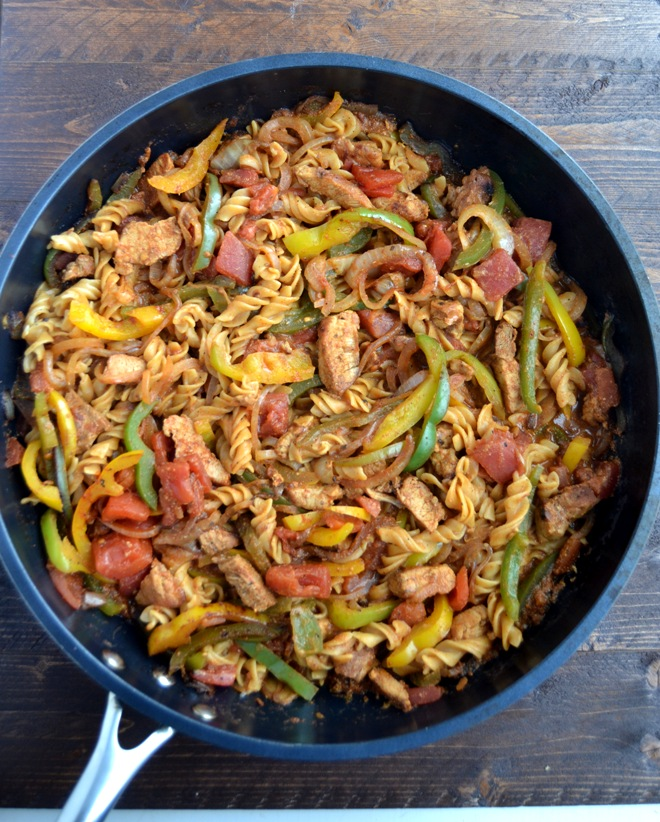 Cajun Pork Pasta is loaded with sauteed bell peppers and onions, Cajun seasoned pork and creamy Cajun noodles and is ready in 30 minutes! www.nutritionistreviews.com
