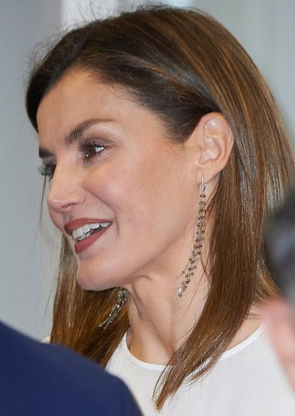 Queen Letizia wore HUGO BOSS Viplisa Skirt and Magrit pumps, Queen Letizia carried Hugo Boss clutch bag at Iberdrola Headquarters