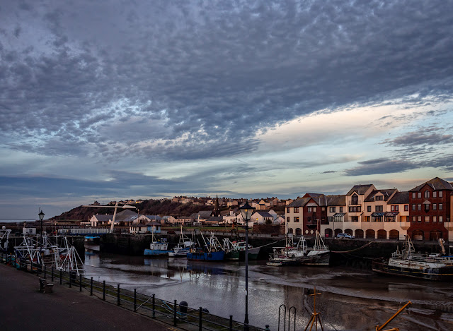 Photo of a dapled sky over Maryport Harbour just before sunset