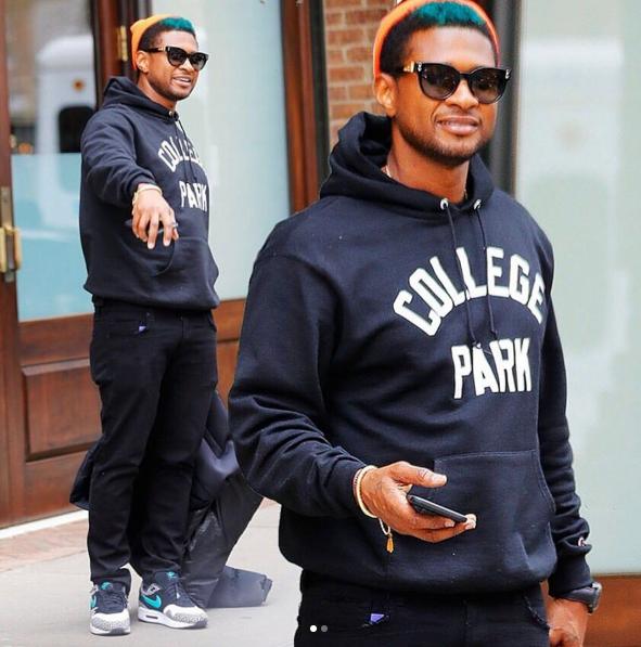 Usher Raymond  rocks Green Hair and Black Hoodie