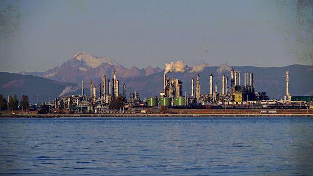 An Anacortes oil refinery is overlooked by Mt. Baker in the distance.