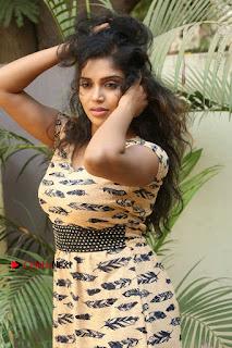 Telugu Actress Karunya Chowdary Stills in Short Dress at ATM Not Working Press Meet  0063.jpg