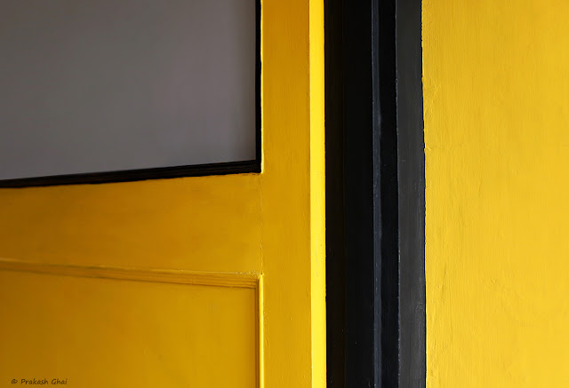 Two Minimal Art Photographs shot inside Cafe Step Out Jaipur in response to a Minimalism Challenge thrown by a Friend. Common Subject being the Yellow Door for Both Photographs.