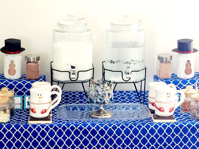 Keep warm this winter with a hot chocolate bar that will be as cute as it is helpful. With just a few items you may already have, you can make a super cute Snowman Hot Chocolate bar that will keep you warm when it's cold outside with a warm cup of cheer.