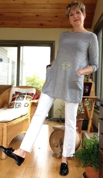 woman in grey tunic, white cropped jeans, and black loafers