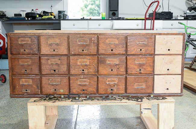 Hardware removed from card catalog and sanded drawers