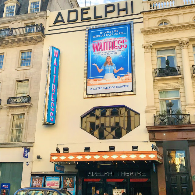 Outside of the Adelphi Theatre with Waitress poster
