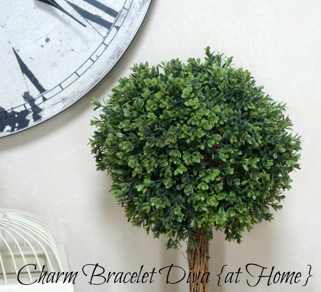 large ball faux plastic boxwood leaves topiary