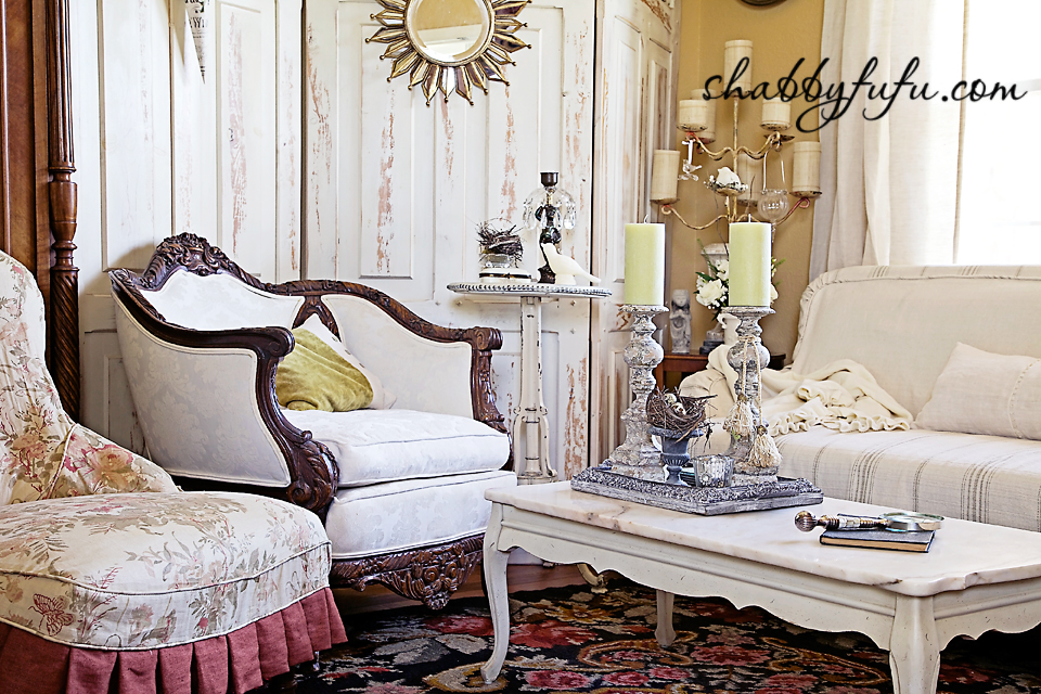 French country decor in Texas - french style living room sitting area with vintage couch, restored coffee table and upholstered sattine