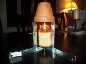 calefacción casera con velas y macetas