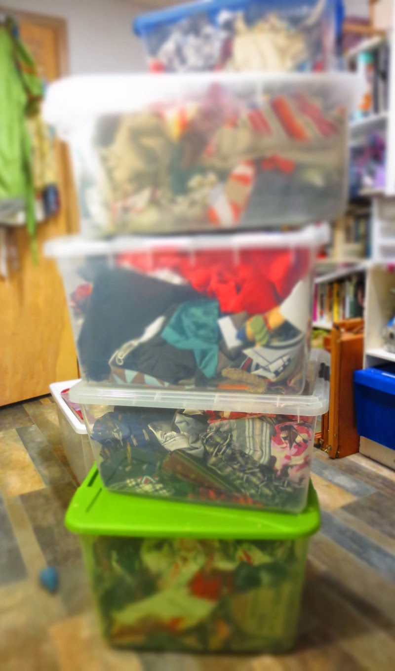 tower of plastic containers storing fabric