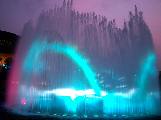 Dragon projection on fountain in Symbio show, Ocean Park
