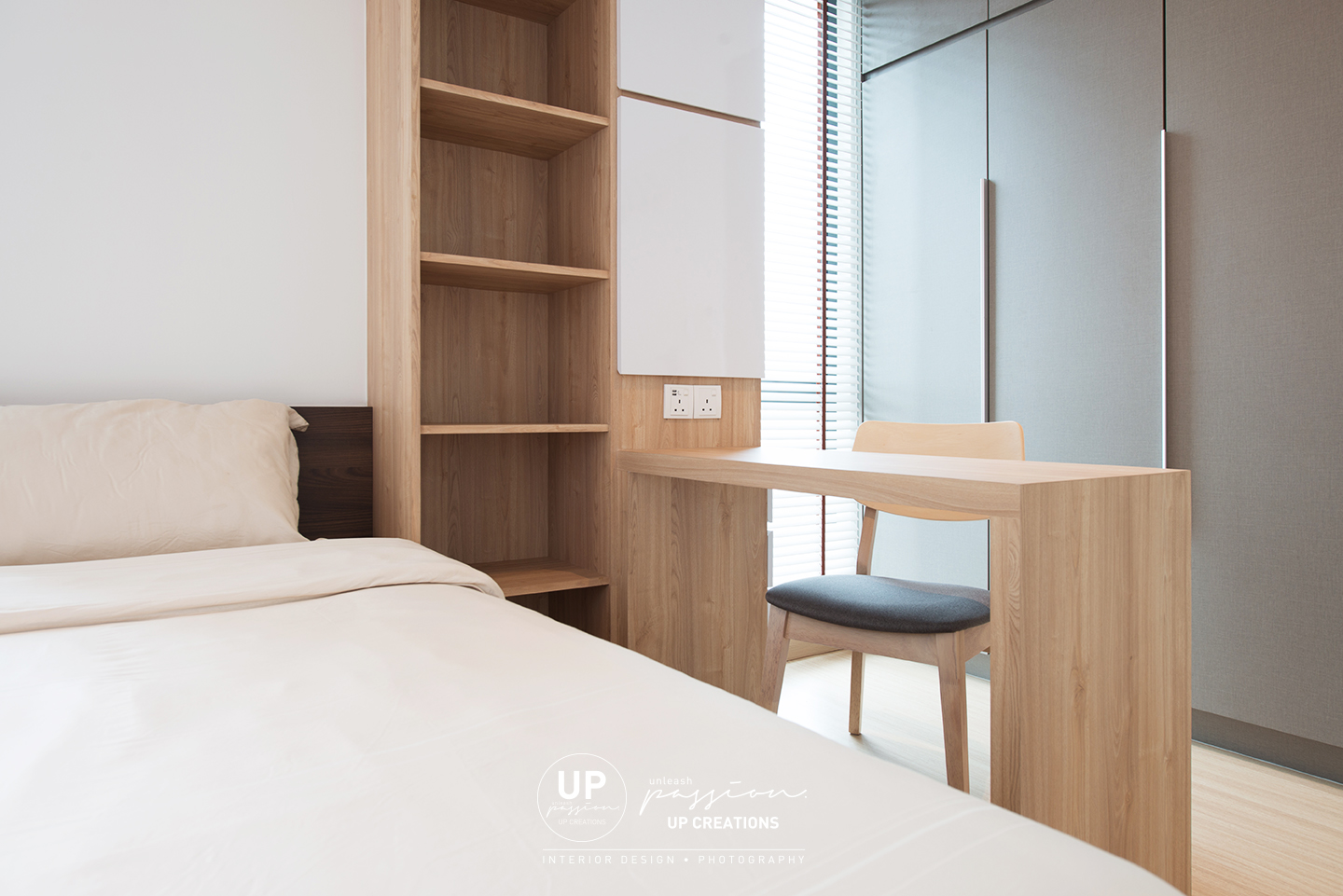 trinity aquata condo guest room with queen size bed and study desk as a divider in front wardrobe which also save space