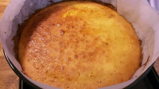 A lemon polenta cake in a cake tin