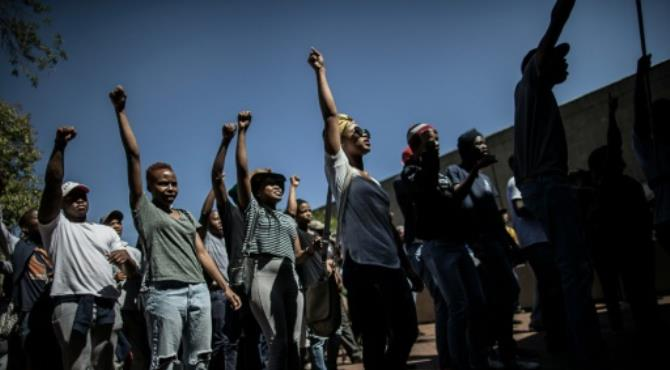 """Despite student protests in Johannesburg, Witwatersrand University will resume after being suspended for three weeks. By MARCO LONGARI (AFP/File) Johannesburg (AFP) - Several South African universities plan to resume classes this week after crippling protests by students demanding free higher education which sparked violent clashes with police, officials said at the weekend.  The prestigious Wits University in Johannesburg, where lectures have been suspended for three weeks, will start functioning again Monday despite students' warnings they will block any such attempt.  The university said the goal of securing """"free, quality higher education"""" could be """"done at the same time as finishing the academic year.""""  On Friday, student protesters at Wits threatened they would continue the shut down until their demand for """"free quality decolonised education"""" was met.  """"No student should see a year's worth of work come to naught, along with the financial sacrifices that they, and their families have had to make,"""" Wits University said a statement."""