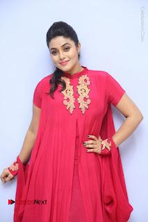Actress Poorna Latest Stills in Red Dress at Rakshasi First Look Launch  0082.JPG