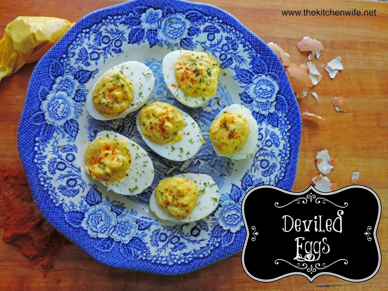 The finished deviled eggs on a plate with the title in the bottom right hand corner.