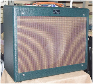 Green levant tolex and oxblood grill cloth cabinet