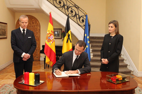 King Felipe signs the book of condolences in the presence of Spanish Queen Letizia and Belgian Ambassador to Spain, Pierre Labouverie,